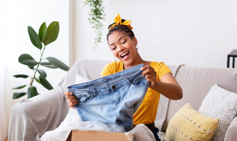 millennial opening new clothes