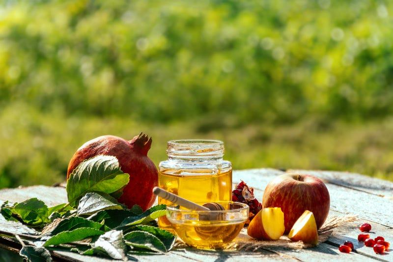 Apple and honey and pomegranate, traditional food of jewish New Year - Rosh Hashana