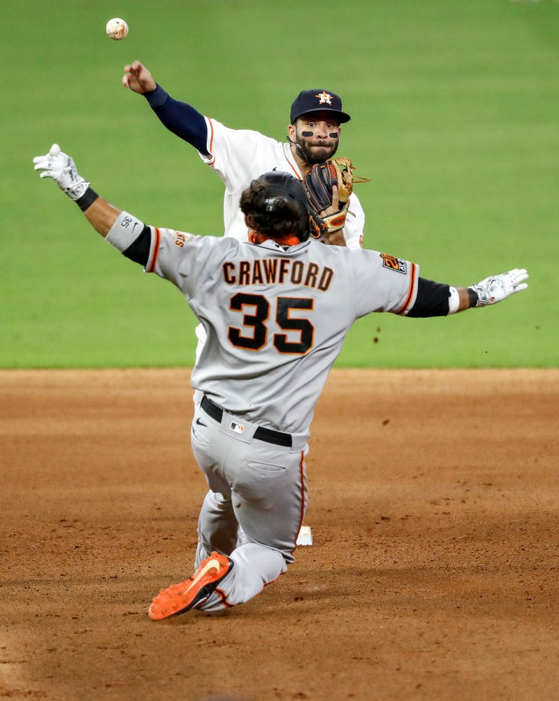 ose Altuve #27 of the Houston Astros forces Brandon Crawford #35 of the San Francisco Giants out at second and throws to first in the fifth inning at Minute Maid Park on August 11, 2020 in Houston