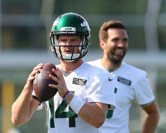 Sam Darnold and Joe Flacco partake in drills in training camp.