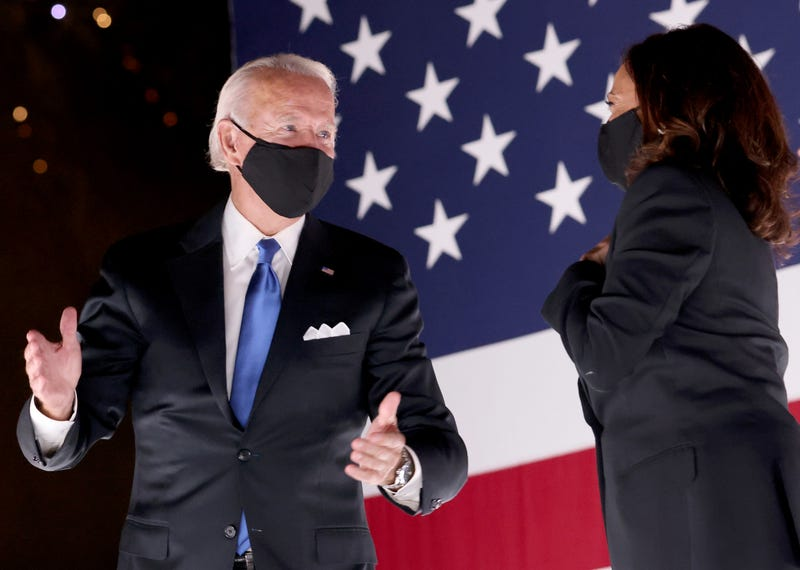 Joe Biden and Kamala Harris confer on stage outside the Chase Center after Biden delivered his acceptance speech on the fourth night of the Democratic National Convention from the Chase Center on August 20, 2020 in Wilmington, Delaware.