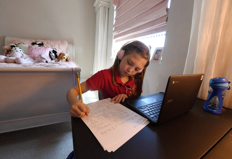 Doral Academy Red Rock Elementary School fourth grader Reaghan Keeler, 9, attends an online reading class from her bedroom on her first day of distance learning amid the spread of the coronavirus (COVID-19) on August 24, 2020