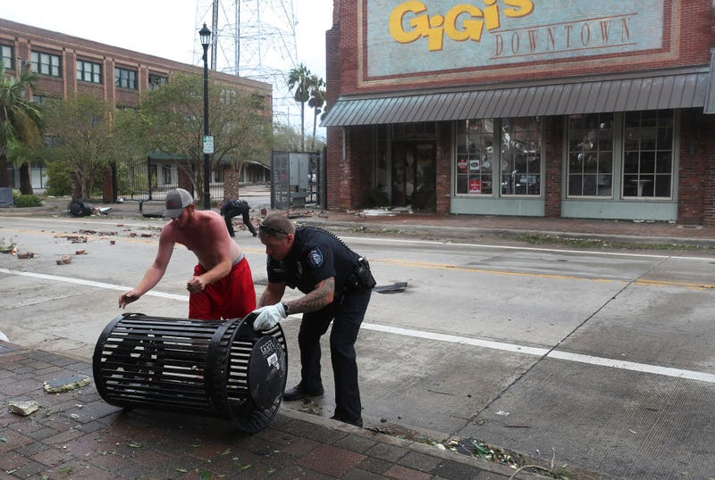 A Lake Charles police officer helps clear the streets in the downtown area after Hurricane Laura passed through on August 27, 2020 in Lake Charles, Louisiana . The hurricane hit with powerful winds causing extensive damage to the city.
