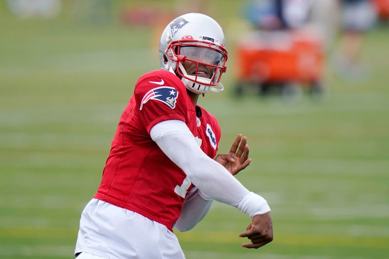 Cam Newton getting his arm loose at Patriots training camp