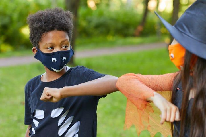 Two kids wearing masks