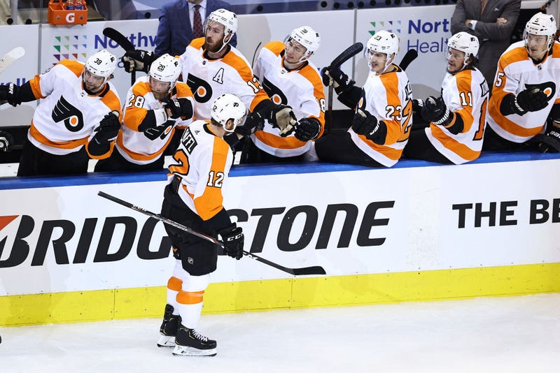 Michael Raffl #12 of the Philadelphia Flyers is congratulated by his teammates after scoring a goal