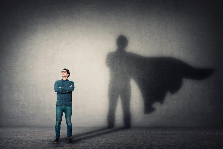Man with superhero cape shadow
