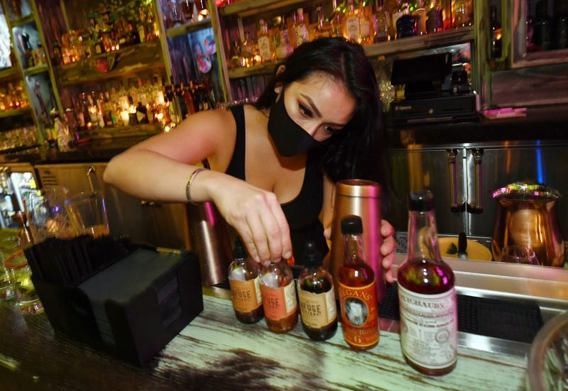 Bartender Brandi Sterner makes drinks after the bartop opened for the first time at Lucky Day bar in the Fremont East Entertainment District on September 21, 2020 in Las Vegas, Nevada.