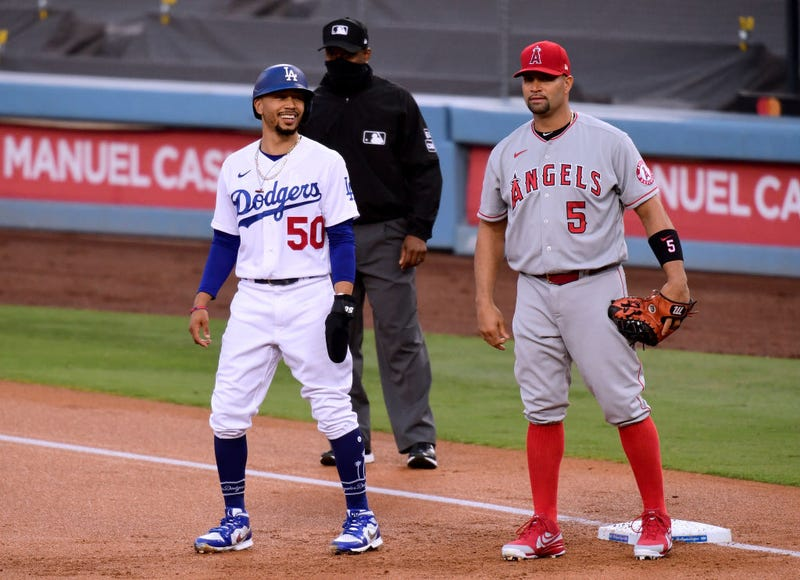Dodgers star Mookie Betts talks with future Hall of Fame Angels first baseman Albert Pujols.