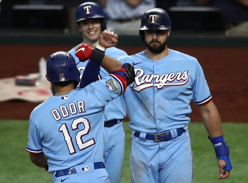 ougned Odor #12 of the Texas Rangers celebrates a three-run home run with Joey Gallo #13 and Nick Solak #15 against the Houston Astros in the fourth inning at Globe Life Field.