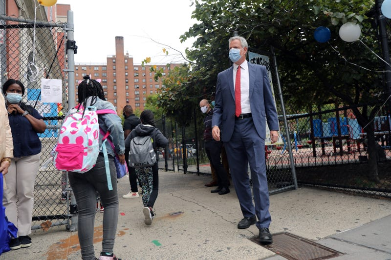 New York City Mayor Bill de Blasio stands at P.S. 188 as he welcomes elementary school students back to the city's public schools for in-person learning on September 29, 2020 in New York City.