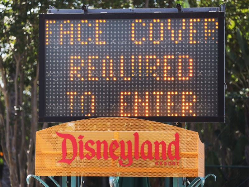 A sign requiring face coverings is posted near an entrance for Downtown Disney District on September 30, 2020 in Anaheim, California.