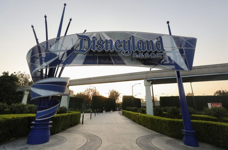 """A Disneyland sign is posted at an empty entrance to Disneyland on September 30, 2020 in Anaheim, California. Disney unveiled an updated annual pass system with four different """"Magic Key"""" levels."""