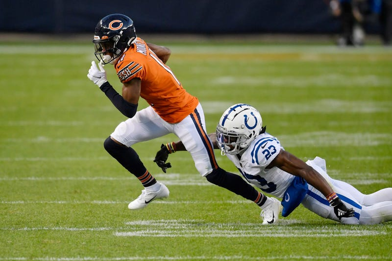 Darnell Mooney runs with the ball against the Colts.