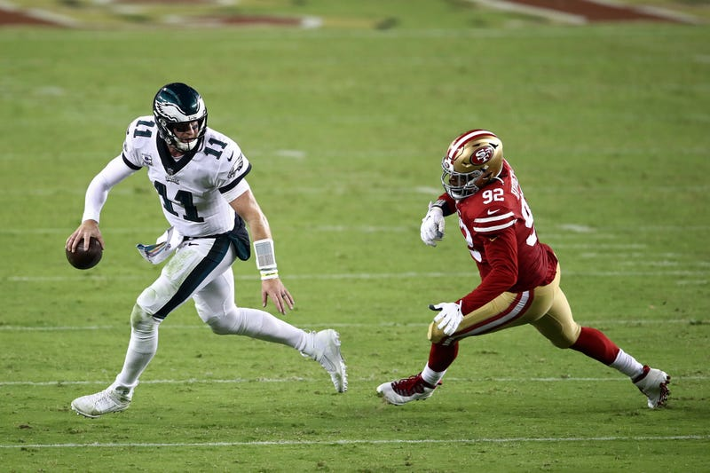 Eagles quarterback Carson Wentz tries to elude the 49ers' pass rush