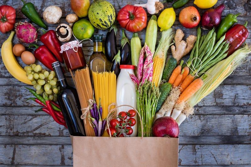 fresh vegetables in a paper bag