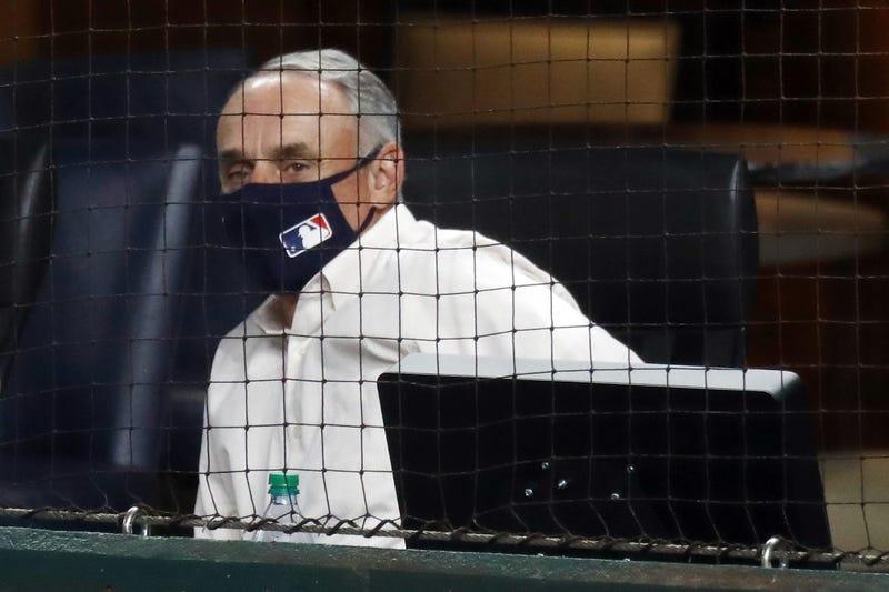 MLB commissioner Rob Manfred watching 2020 postseason game.