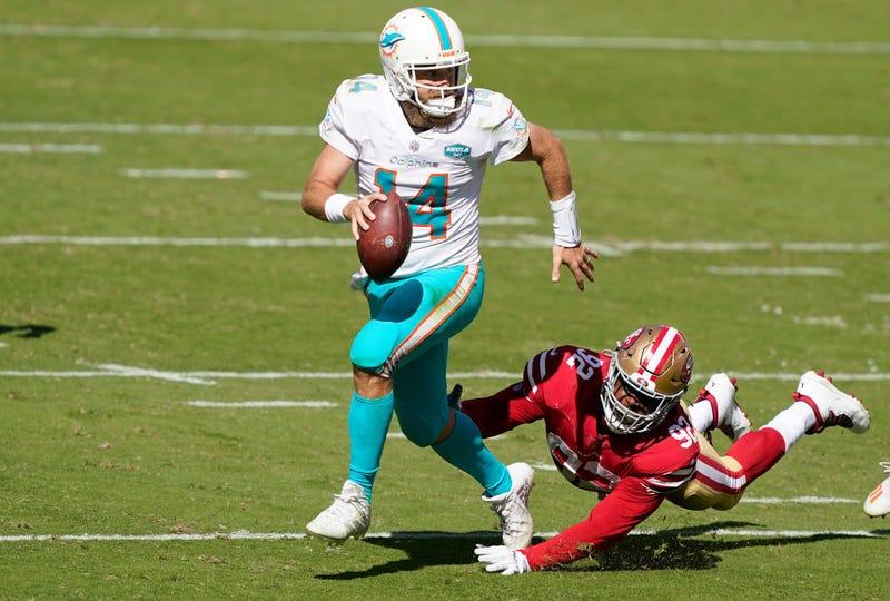 Ryan Fitzpatrick outruns a 49ers defender.