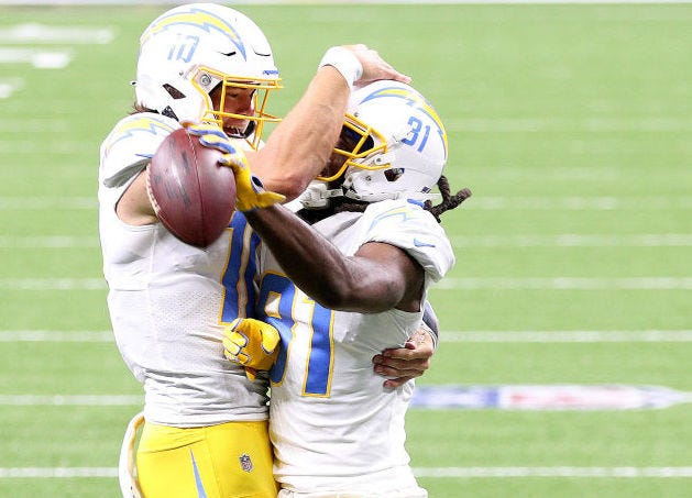Justin Herbert and Mike Williams (right) celebrate a touchdown against the Saints.