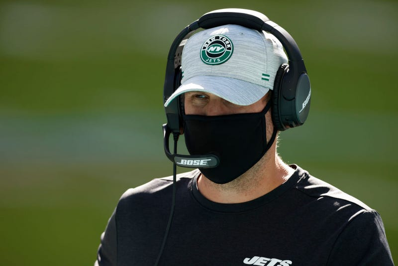 Adam Gase looks on in the Jets-Dolphins game.