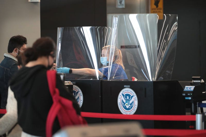 A Transportation Security Administration (TSA) agent screens an airline passenger at O'Hare International Airport on October 19, 2020 in Chicago, Illinois. Yesterday the TSA reported that it had screened over 1 million passengers, representing the highest number of passengers screened at TSA checkpoints since March 17, 2020. During the week ending October 18, TSA screened 6.1 million passengers nationwide, the highest total since the start of the COVID-19 pandemic. (Photo by Scott Olson/Getty Images)