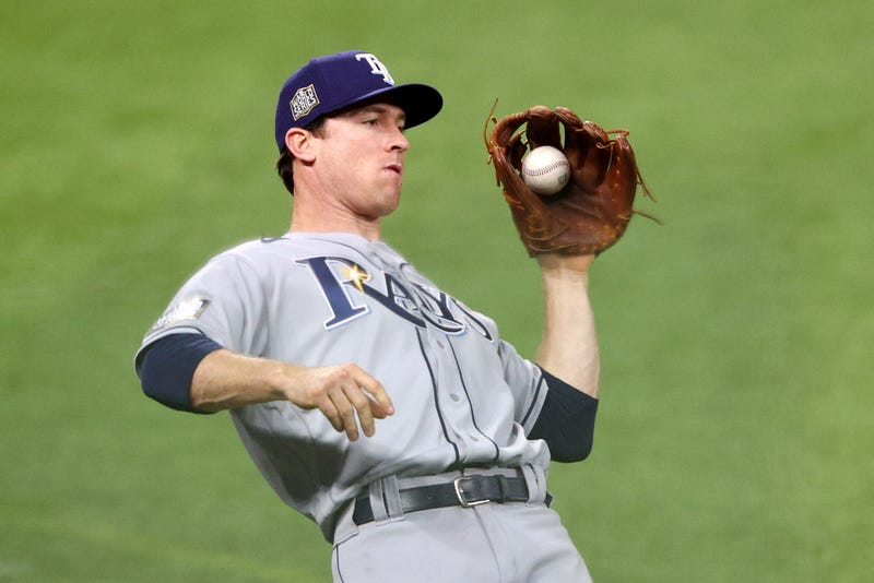Tampa Bay Rays second baseman Joey Wendle catches a fly ball against the Los Angeles Dodgers during the fifth inning in Game Two of the 2020 MLB World Series at Globe Life Field on October 21, 2020 in Arlington, Texas.