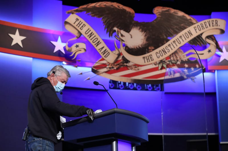 A person uses disinfecting wipes to clean the lectern that will be used by President Donald Trump during the second presidential debate at the Curb Event Center on the campus of Belmont University on October 22, 2020 in Nashville, Tennessee. President Trump and Democratic presidential nominee Joe Biden are scheduled to square off for the final debate, 12 days before Election Day.