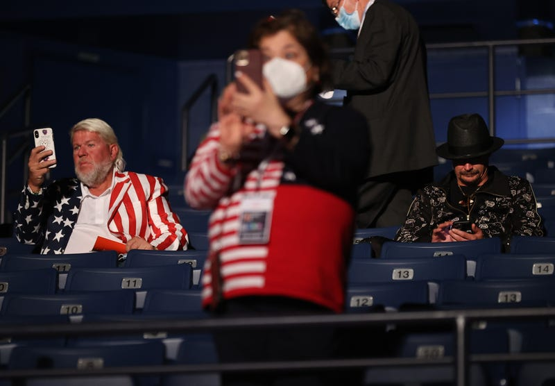 Kid Rock (R) and John Daly take their seats without wearing masks, prior to being asked to wear them, at the final presidential debate between U.S. President Donald Trump and Democratic presidential nominee Joe Biden at Belmont University on October 22, 2020 in Nashville, Tennessee. This is the last debate between the two candidates before the election on November 3.