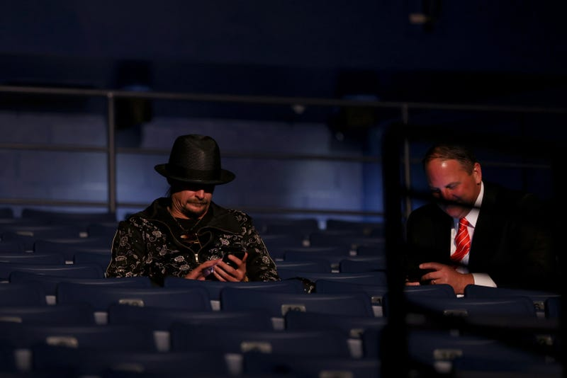 Kid Rock (L) takes his seat without wearing a mask, prior to being asked to wear one, at the final presidential debate between U.S. President Donald Trump and Democratic presidential nominee Joe Biden at Belmont University on October 22, 2020 in Nashville, Tennessee. This is the last debate between the two candidates before the election on November 3.