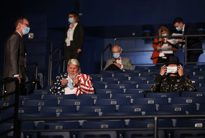 Kid Rock (R) and John Daly are asked to wear masks, at the final presidential debate between U.S. President Donald Trump and Democratic presidential nominee Joe Biden at Belmont University on October 22, 2020 in Nashville, Tennessee.