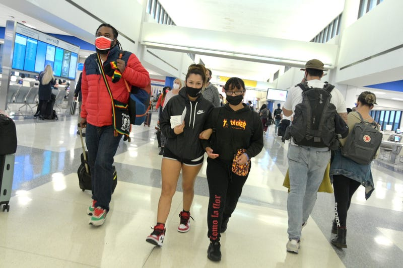 Air travelers walk towards their gates after passing through security at Newark Liberty International Airport on October 22, 2020 in Newark, New Jersey. The global pandemic has had a devastating impact on aviation and airlines don't believe they will see much improvement until a reliable COVID-19 vaccine is developed and distributed.
