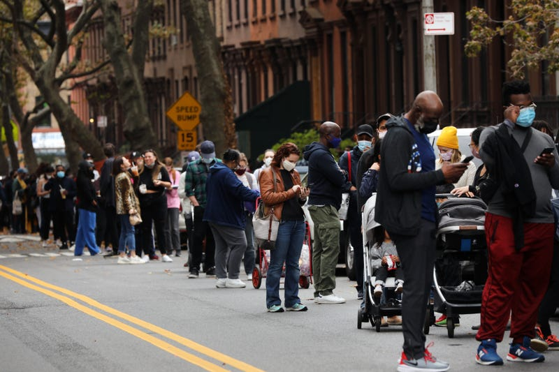 People wait in line outside of a Masonic temple in Brooklyn as early voting begins on October 24, 2020 in New York City.