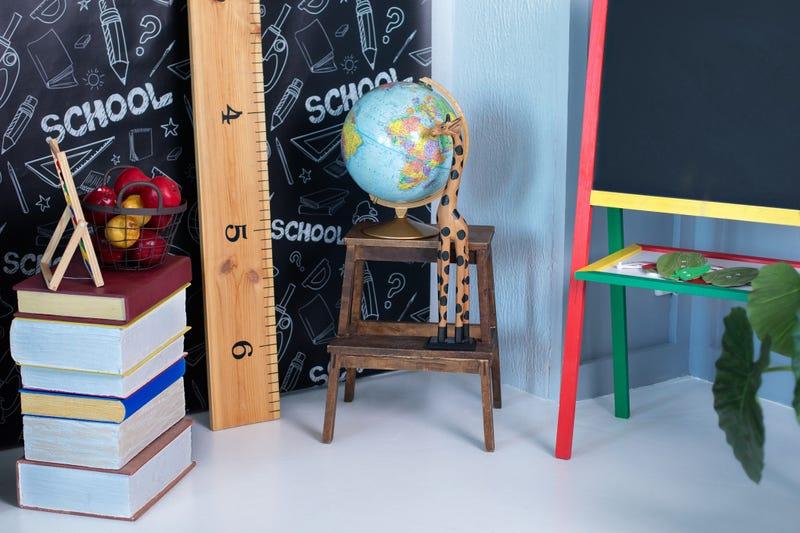 Interior of elementary school. Chalkboard, Books, globe and stationery on classroom. Teachers Day concept. Back to school. Empty classroom with blackboard. Kindergarten. Interior of children's room