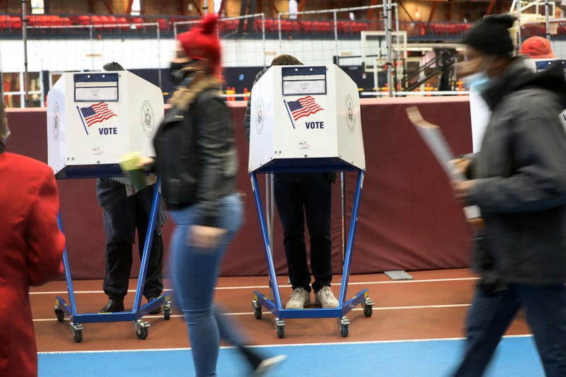 People vote at the Brooklyn Armory during early voting on October 28, 2020 in New York City.