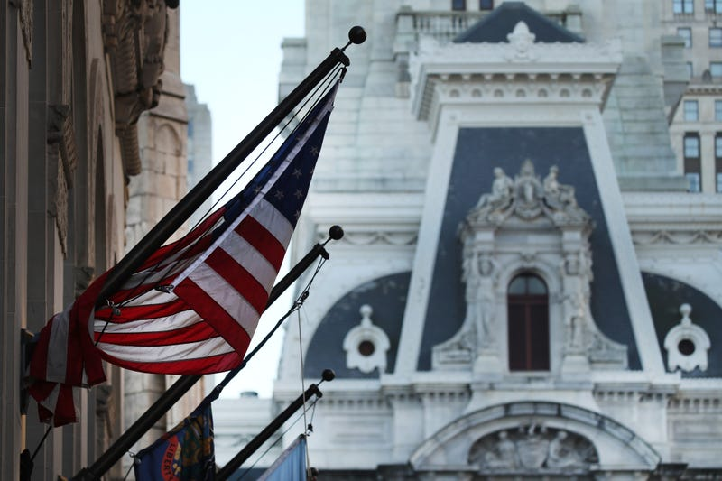 An American Flag hangs from a building in Philadelphia the morning after Americans voted in the presidential election on November 04, 2020