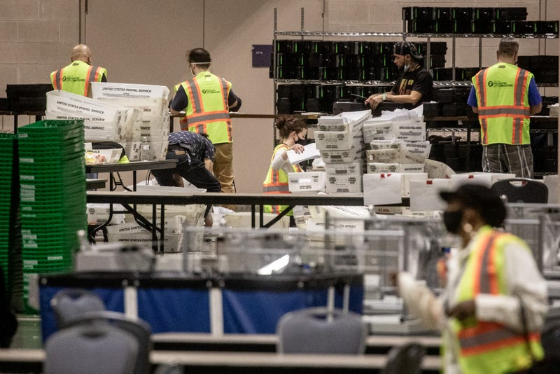 Votes continue to be counted at the Pennsylvania Convention Center in Philadelphia.