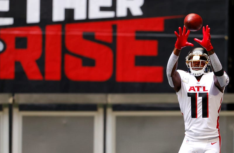 Falcons wide receiver catching a pass on the field.