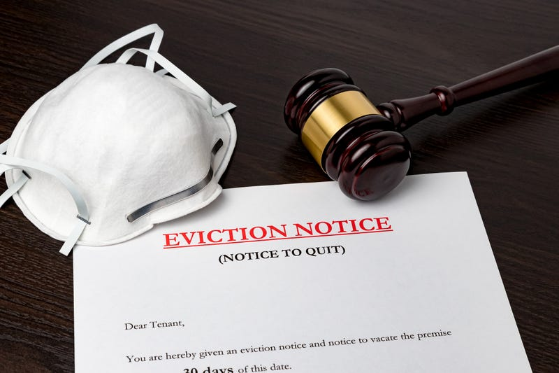 Eviction notice document with gavel and N95 face mask