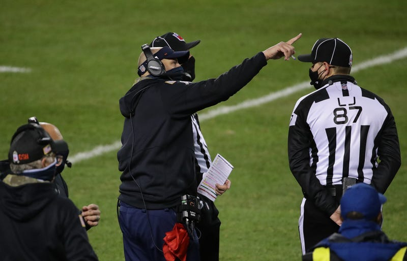 Matt Nagy of the Chicago Bears discusses a play with game officials in the game against the Minnesota Vikings at Soldier Field on November 16, 2020 in Chicago, Illinois.