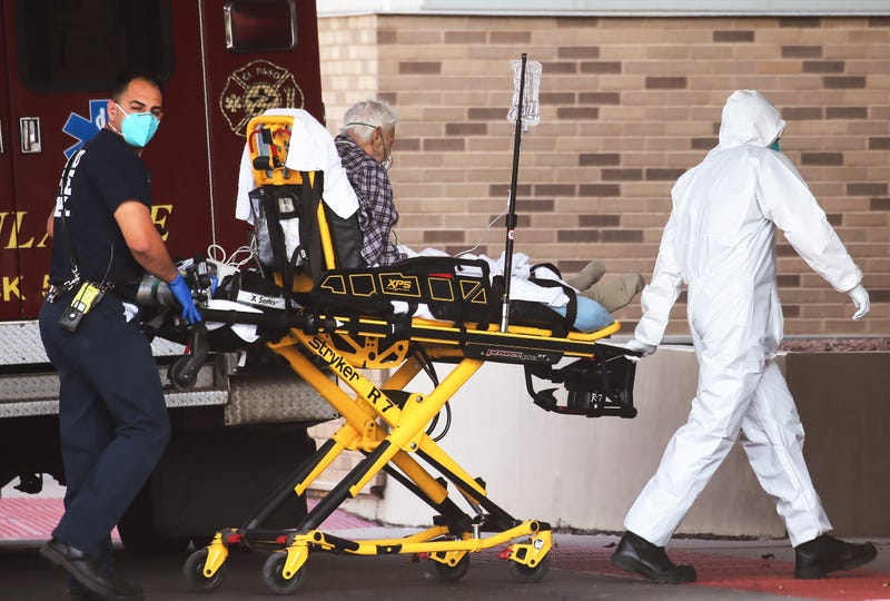 medical worker in full PPE (personal protective equipment) helps transport a patient into University Medical Center amid a surge of COVID-19 cases in El Paso on November 17, 2020 in El Paso, Texas.