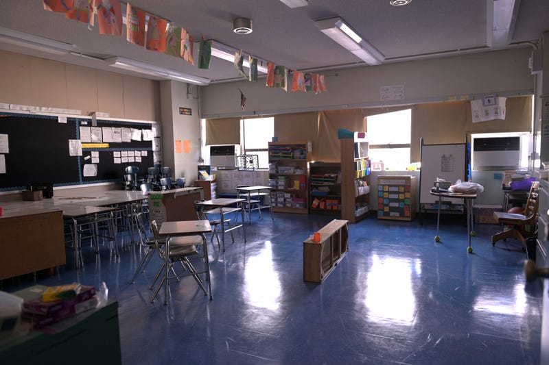 A classroom is empty with the lights off on what would otherwise be a blended learning school day on November 19, 2020 at Yung Wing School P.S. 124 in New York City.