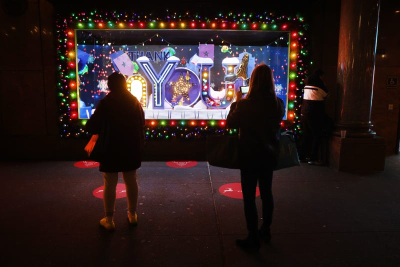 People look at the newly revealed Macy's Herald Square holiday windows on November 19, 2020 in New York City.