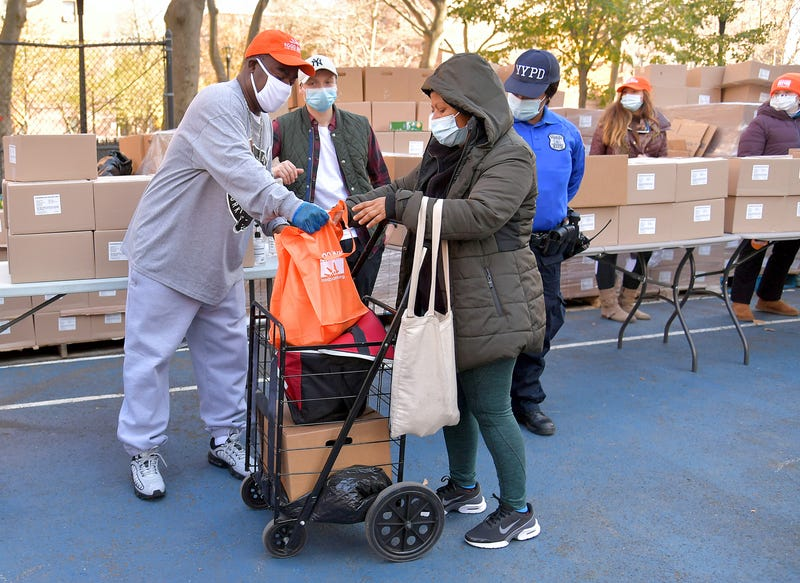 Tracy Morgan (L), Food Bank For New York City, and Council Member Robert E. Cornegy Jr. distribute turkeys to Brooklyn families in celebration of Thanksgiving on November 21, 2020 in Brooklyn, New York.