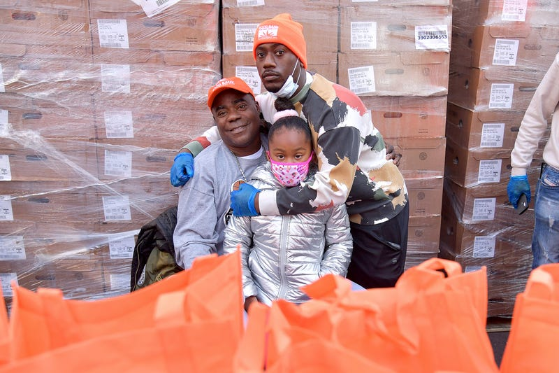 (L-R) Tracy Morgan, Maven Sonae Morgan, and Tracy Morgan Jr. pose as Food Bank For New York City, Tracy Morgan, and Council Member Robert E. Cornegy Jr. distribute turkeys to Brooklyn families in celebration of Thanksgiving on November 21, 2020 in Brooklyn, New York.