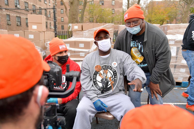 Edgar Berlanga (L) and Tracy Morgan (C) attend as Food Bank For New York City, Tracy Morgan, and Council Member Robert E. Cornegy Jr. distribute turkeys to Brooklyn families in celebration of Thanksgiving on November 21, 2020 in Brooklyn, New York.