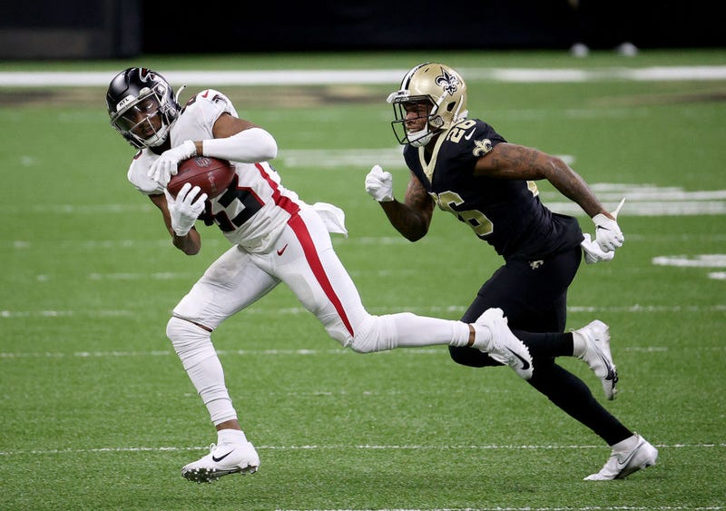 Russell Gage catches a pass against the Saints.