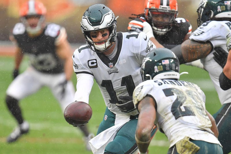 Carson Wentz #11 of the Philadelphia Eagles hands the ball to Miles Sander