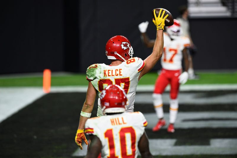 Travis Kelce holds up the football after scoring against the Raiders.