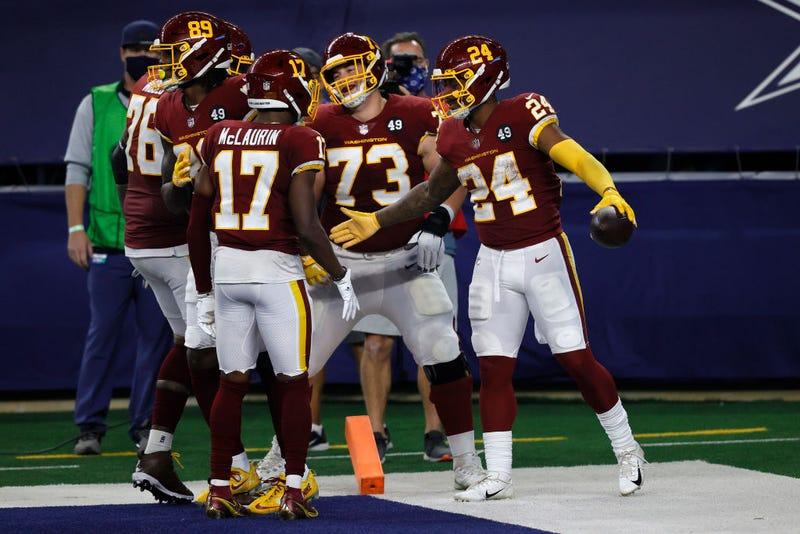 The Washington Football Team celebrates a touchdown against the home team Dallas Cowboys.