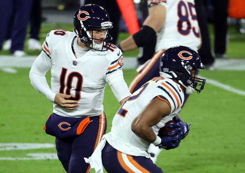 Mitchell Trubisky hands the ball off to David Montgomery.